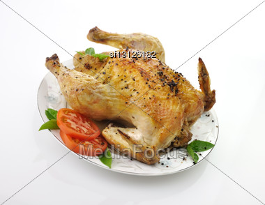 Roasted Chicken With Fresh Tomatoes And Basil Leaves Stock Photo