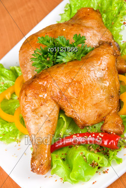 Roasted Chicken Ham Garnished With Fresh Green Salad, Pepper And Greens Stock Photo