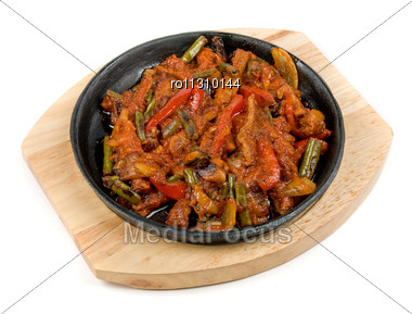 Roasted Meat With Vegetables At Pan Stock Photo