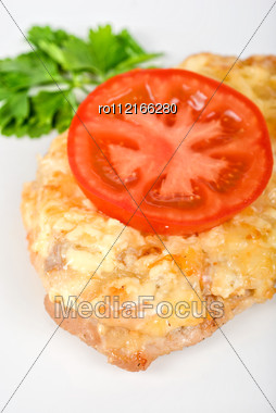 Roasted Pork Steak Baked With Cheese And Tomato Stock Photo