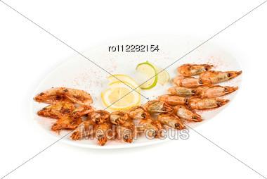 Roasted Shrimps With Lemon Closeup Isolated Stock Photo