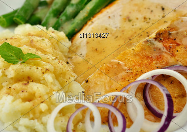 Roasted Turkey Slices With Mashed Potatoes And Green Beans Stock Photo