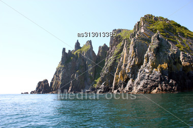 Rocks In The Blue Sea, Background. Stock Photo