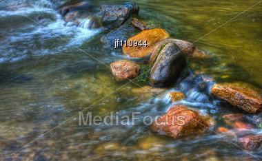 Rocks And Rolling River In High Dynamic Range Stock Photo