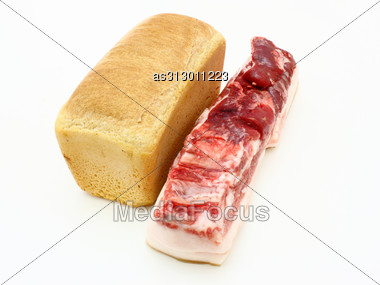 Roll Of Fresh Bread And The Big Piece Of Fat With Meat Stock Photo