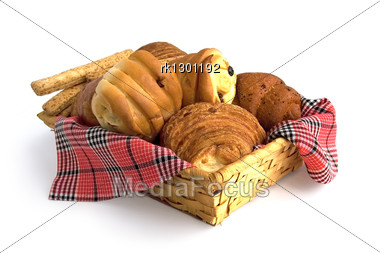 Rolls, Croissants, Bread Sticks In A Wicker Basket On A Red Checkered Napkin Isolated Stock Photo