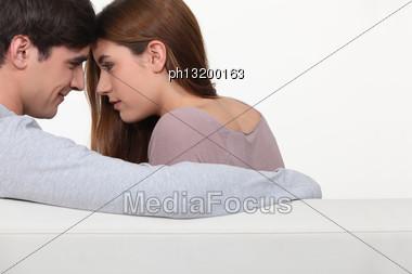 Romantic Couple On Sofa Stock Photo