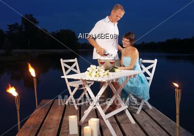 Romantic Dinner Outdoors On The Dock Stock Photo