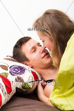 Romantic Moment - Young Couple Kissing In Bed Stock Photo