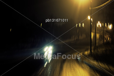 Romantic Night View Of The Road Turn With Lanterns. Blurred Shot Stock Photo