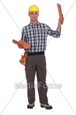 Roofer Displaying Tiles Stock Photo