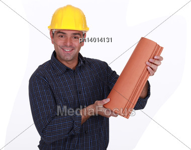 Roofer Holding Tiles Stock Photo