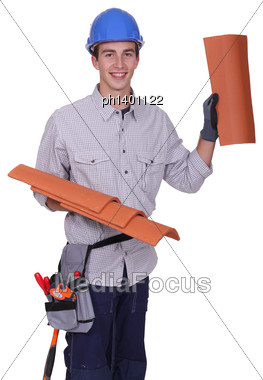 Roofer Showing Tiles, Studio Shot Stock Photo