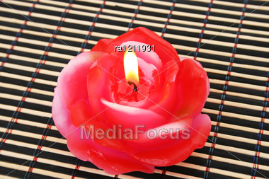 Rose Candle On Wooden Math. Stock Photo