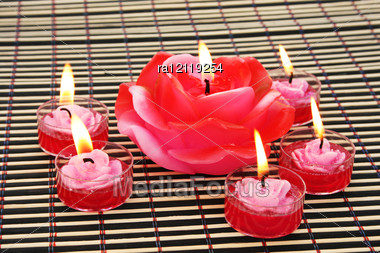 Rose Candles On Wooden Math. Stock Photo