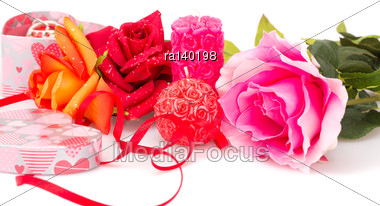 Roses, Candles, Red Ribbon And Gift Box Isolated On White Background Stock Photo