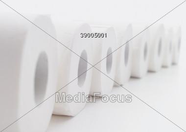 Row Of Bathroom Tissue Paper Rolls Stock Photo