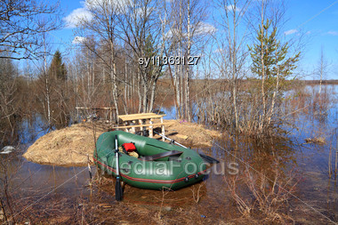Rubber Boat On Coast River Stock Photo
