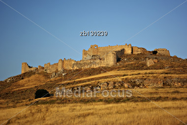 Ruins Of Ancient Argos Castle At Peloponnese Peninsula, Greece At Sunny Summer Day Against Clear Blue Sky. Stock Photo