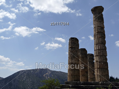 Ruins Of Apollo Temple At Delphy At Sunny Smmer Day Agains Blue Sky Stock Photo