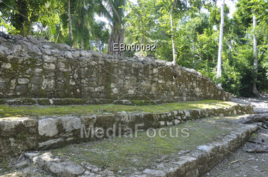 Ruins of foundations of Mayan houses at Chacchoben, Mexico Stock Photo