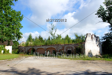 Ruins Of The House On A Background Of The Cloudy Sky Stock Photo
