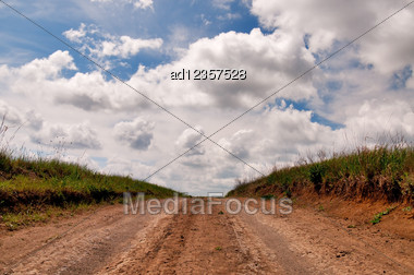 Rural Dirt Road And Cloudscape Stock Photo