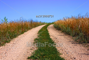 Rural Road And The Blue Sky Stock Photo