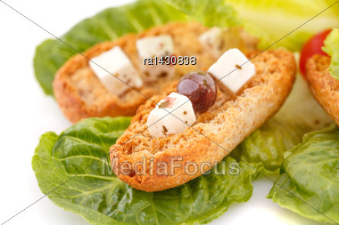 Rusks, Feta Cheese And Vegetables On White Background Stock Photo