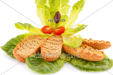 Rusks And Vegetables Isolated On White Background Stock Photo