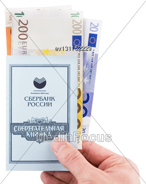 Russian Savings Book With The Euros, Holding In Hand. Isolated Stock Photo