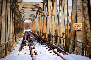 Rusty Bridge And Abandoned Railroad Tracks In Winter Stock Photo