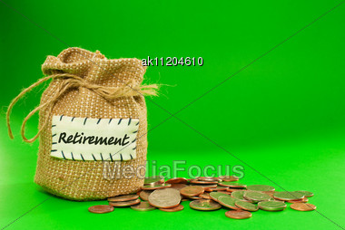 Sack Full Of Coins Over Green Background Stock Photo
