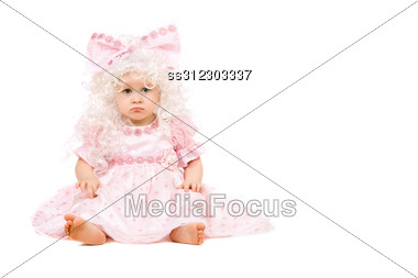 Sad Baby Girl In A Pink Dress. Stock Photo
