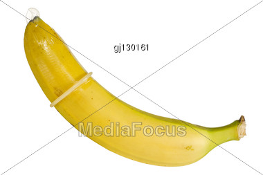 Safe Sex Concept. Banana In A Condom Isolated On White Background. Stock Photo