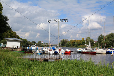 Sailboats On Quay Stock Photo