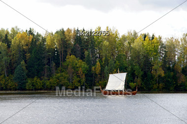 Sailing Boat On A Background Of A Forest Stock Photo