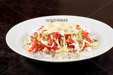 Salad From Beef Tongue, Cervelat, Chicken Meat, Fresh Tomatoes, Cucumbers, Pepper, Eggs, Cheese And Mayonnaise Stock Photo