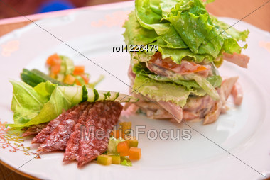 Salad From Different Kinds Of Sausages, Cucumbers, Peppers, Lettuce With Sour Cream Sauce Stock Photo