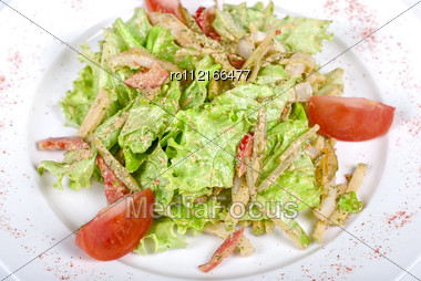 Salad Of Squid With Roast Chicken Meat, Apples, Tomatoes, Eggs And Peppers Stock Photo