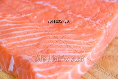 Salmon Closeup Slice At Wooden Board Stock Photo