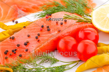 Salmon Fillet With Lemon, Dill, Pepper, Tomatoes On Plate Stock Photo