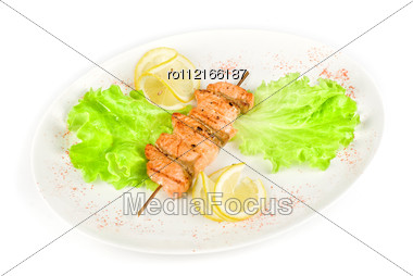 Salmon Kebab At Plate With Green Lettuce And Lemon On A White Stock Photo