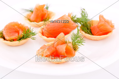 Salmon Rolled Fillet In Pastries On Plate Stock Photo