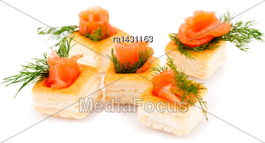 Salmon Rolled Fillet In Pastries Isolated On White Background Stock Photo