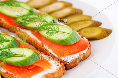 Salmon Sandwiches With Fresh And Pickled Cucumber On Plate Closeup Image Stock Photo