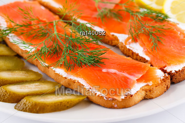 Salmon Sandwiches With Pickled Cucumber And Lemon On Plate Closeup Image Stock Photo