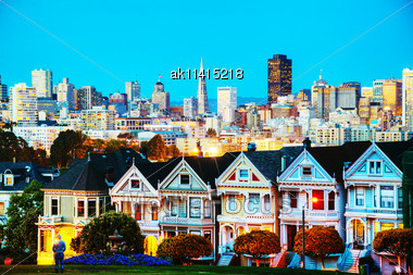 San Francisco Cityscape With The Painted Ladies As Seen From Alamo Square Park Stock Photo