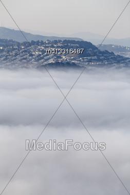 San Fransisco Skyline Fog Rolling In Morning Sunrise Stock Photo