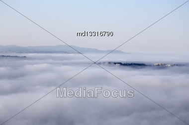 San Fransisco Skyline Fog Rolling In Morning Sunrise Stock Photo